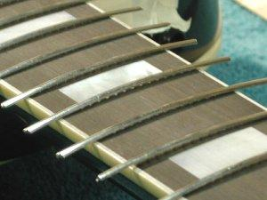 Fig. 14 - Frets are arched, tang is trimmed away and frets are ready to by hammered in