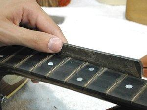 Fig. 18 - Beveling the fret edges with custom files