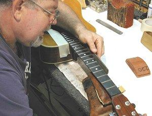 Fig. 19 - Beck beveling the frets on a Martin